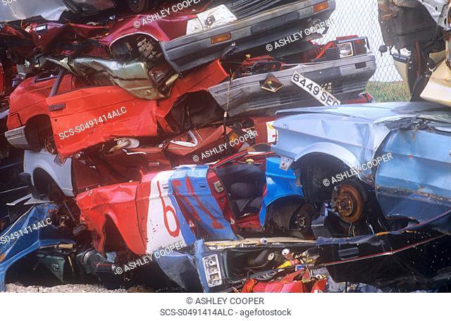 Old cars at a scrap dealers in Barrow in Furness, Cumbria, UK