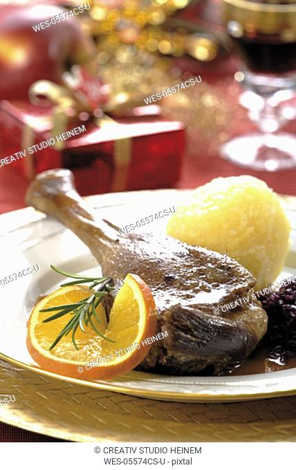 Roast goose with side dishes and christmas dekoration