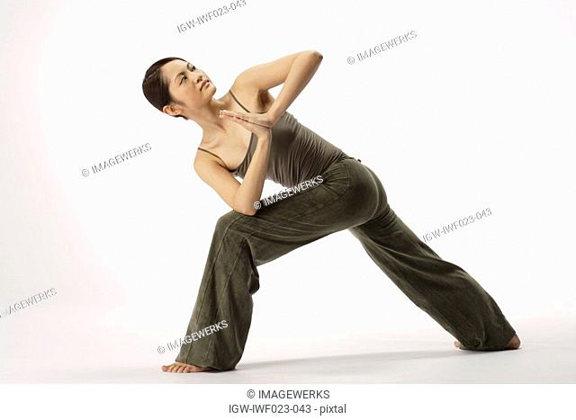 View of a young woman stretching her body