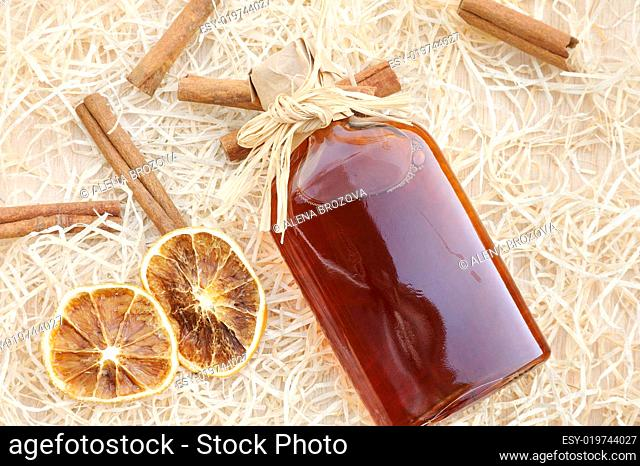 Homemade liqueur with spices still life