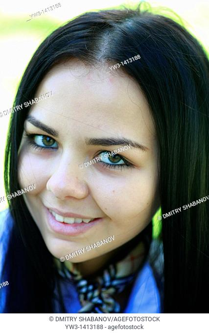 Closeup portrait of a beautiful 20-25 years happy woman in blur background outdoors