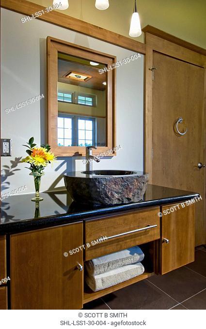 Custom designed master bath vanity with granite sink