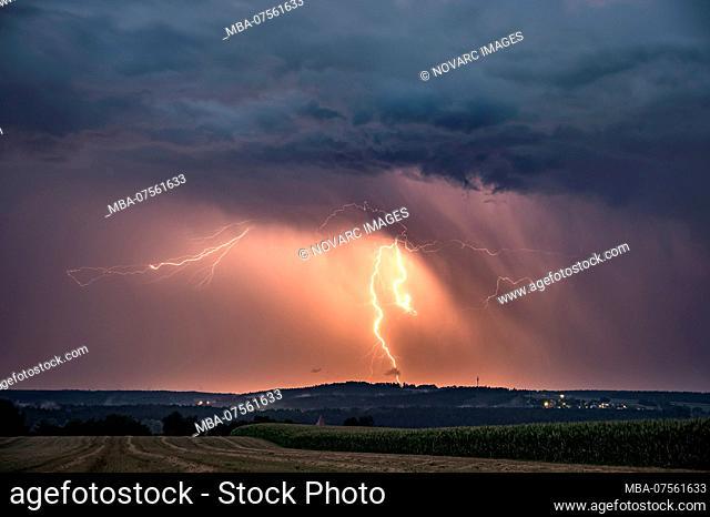 Precipitation lit by earth lightning on the back of a pulling super cell near Feuchtwangen, Baden-Wrttemberg, Germany