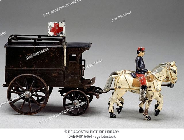 Horse-drawn military ambulance, painted tin toy, made by Charles Rossignol, 1912. France, 20th century.  Milan, Museo Del Giocattolo E Del Bambino (Toys Museum)