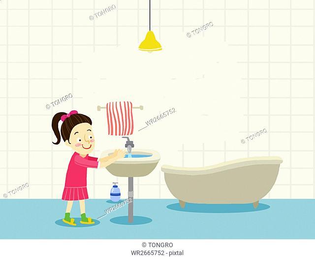 Smiling girl washing her hands