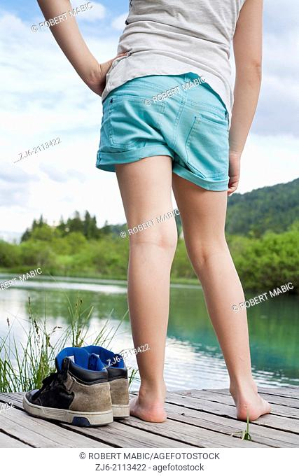 Girl standing on a decking