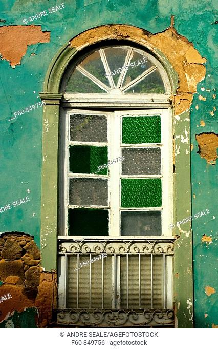 Window in an old façade, historical center, Sao Luis, Maranhao, Brazil
