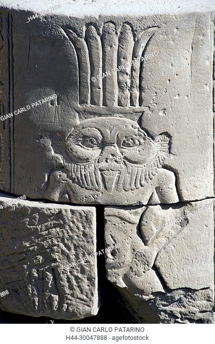Dendera Egypt, ptolemaic temple dedicated to the goddess Hathor. Carvings with the god Bes in a capitol rock