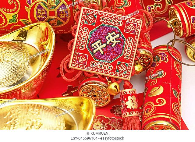 Assorted chinese new year decorations on red background