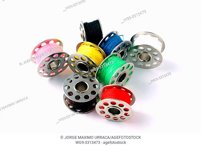 Assorted Colours Thread Reels on white background