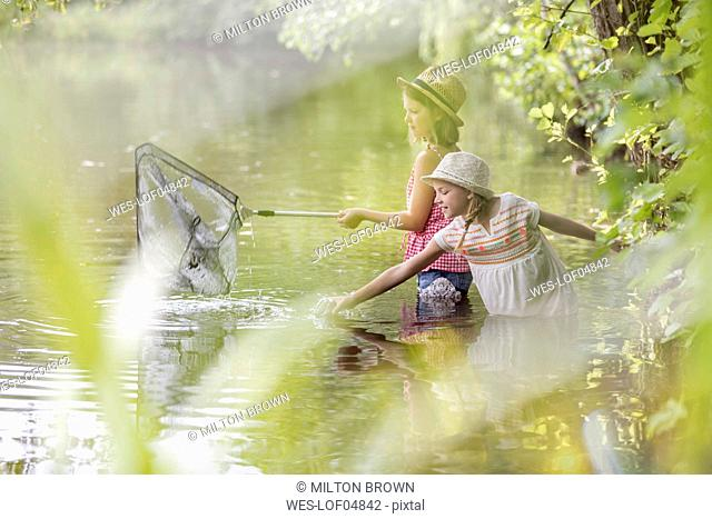 Two girls fishing together in a lake