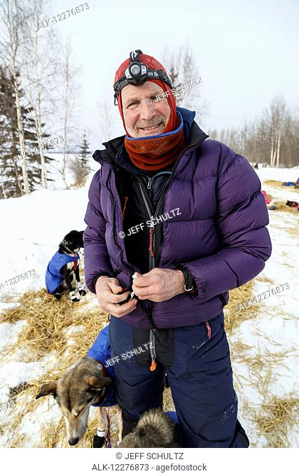 Dr. Mark Selland with his dog team along the Yukon River at the Tanana checkpoint during Iditarod 2015