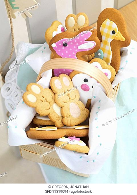 Various Easter biscuits in a wooden basket