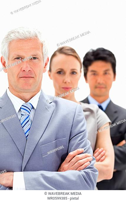 Close-up of a business man with subordinates behind him