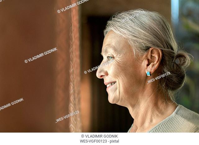 Profile of smiling senior woman