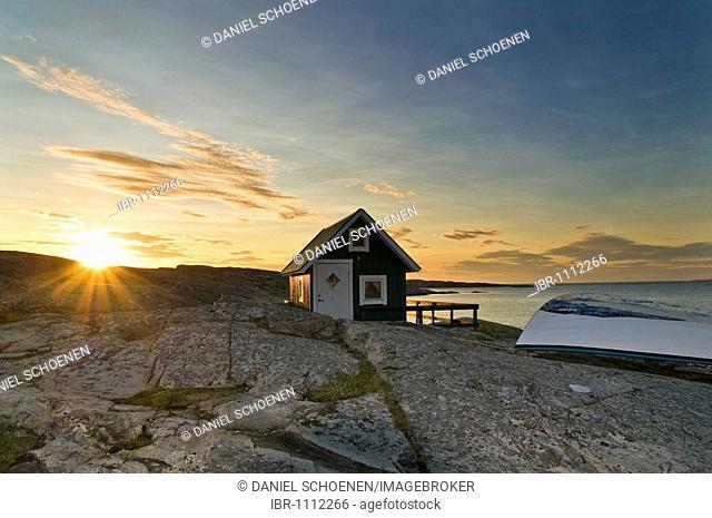 Cabin with row boat, sunset, Smoegen, Bohuslaen, Sweden
