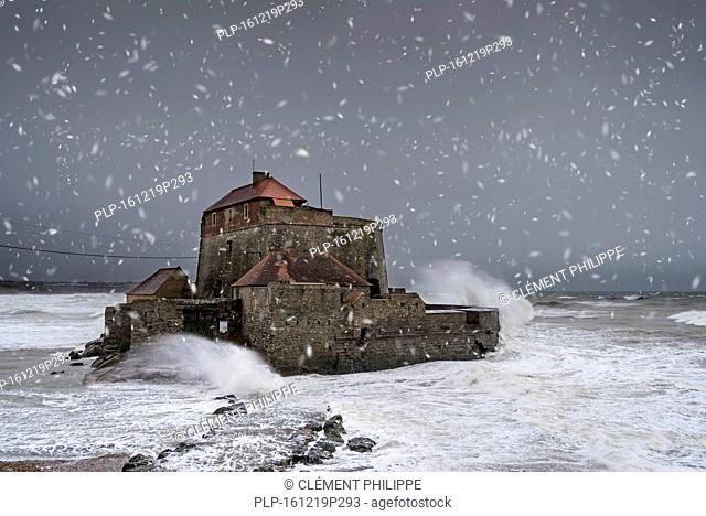 Waves crashing against Vauban's Fort Mahon at Ambleteuse during winter storm along the North Sea coast, Côte d'Opale / Opal Coast, France