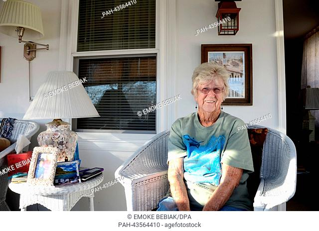 Flo Birban sits in her rebuilt home that was destroyed by hurricane 'Sandy' in Seaside Heights, New Jersey, USA, 20 October 2013