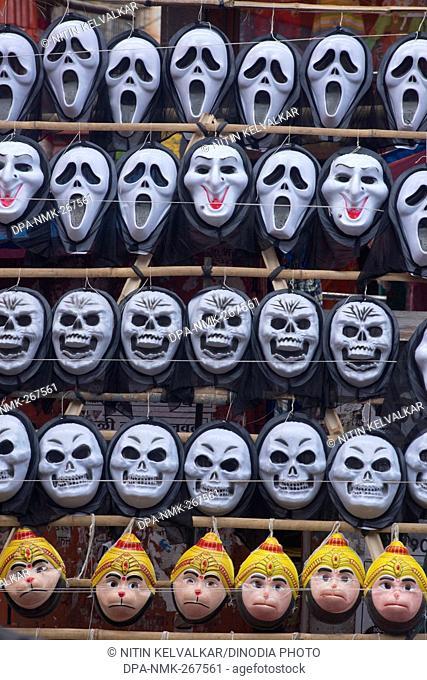 Plastic masks of Ghost Scull and Hanuman kept for sell, Pune Maharashtra India Asia