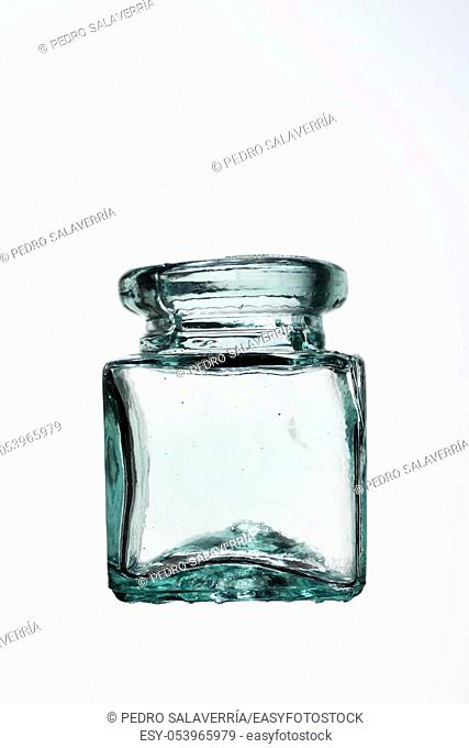 Glass bottle and white background