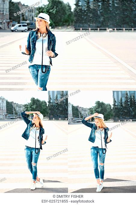 Beautiful young woman in a hat and jeans jacket with a disposable coffee cup, standing on the road with zebra crossing, drinking coffee