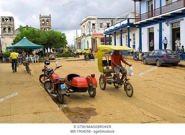 Street scene, Plaza Marti with colorful colonial houses, Baracoa, Guantanamo province, Cuba