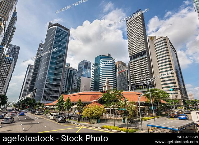 Singapore Street scene in Singapore at sunny day with the Telok ayer market and tall skyscrapers on a background view in Singapore