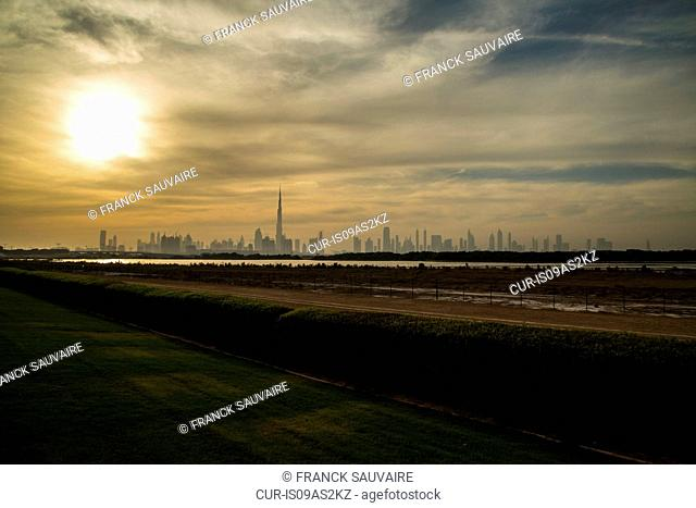 Distant view of Burj Khalifa and city skyline at dawn, Dubai