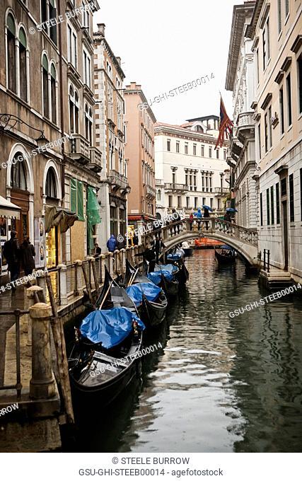 Row of Gondolas in Canal, Venice, Italy