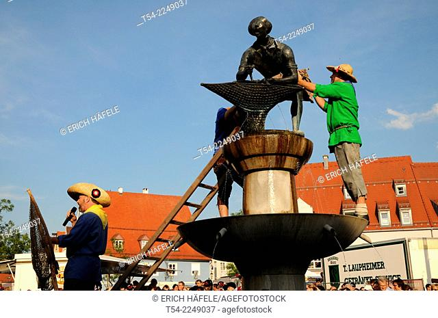 The investiture of the fisherman on the fountain at Schrannenplatz in Memmingen, Fishing Day in Memmingen / Allgaeu