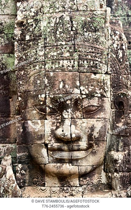 Giant stone face at the Bayon temple at Angkor Wat in Siem Reap, Cambodia