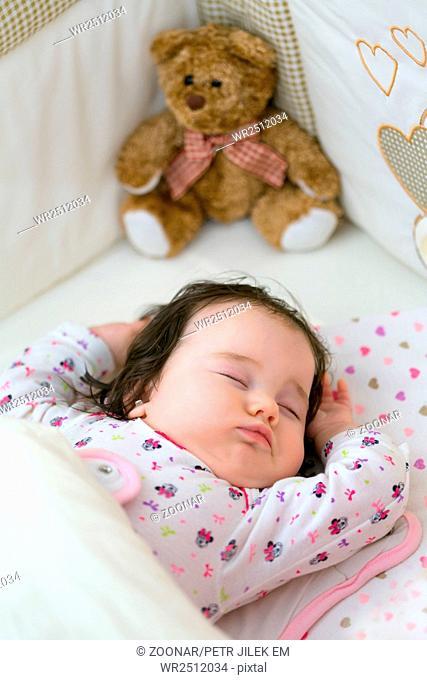 Beautiful little girl in her sleep stretching