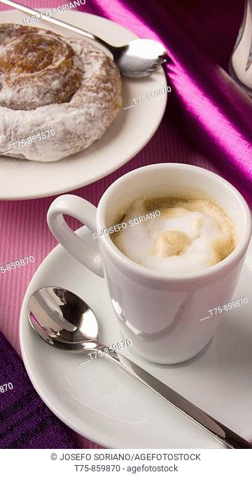 Coffee with cream and ensaimada