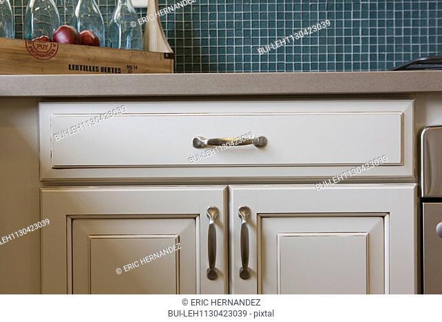 White cabinets in domestic kitchen