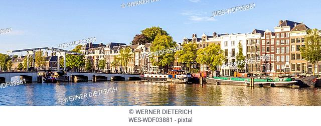 Netherlands, Amsterdam, view to Magere Brug and row of historical houses at Amstel River