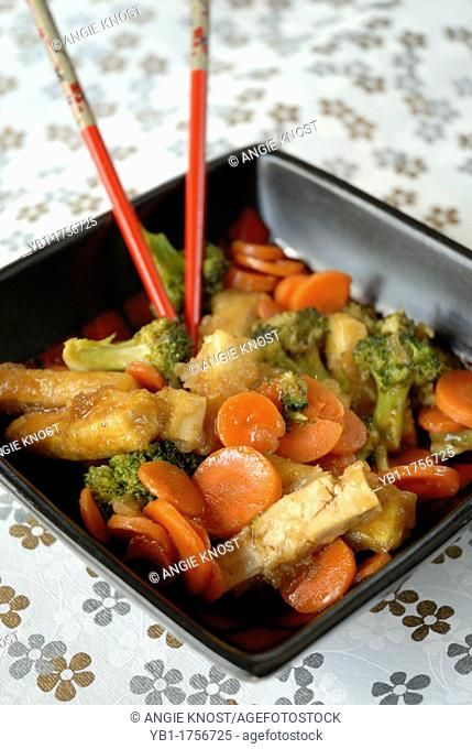 Tofu with vegetables in orange sauce, vegetarian and vegan cuisine