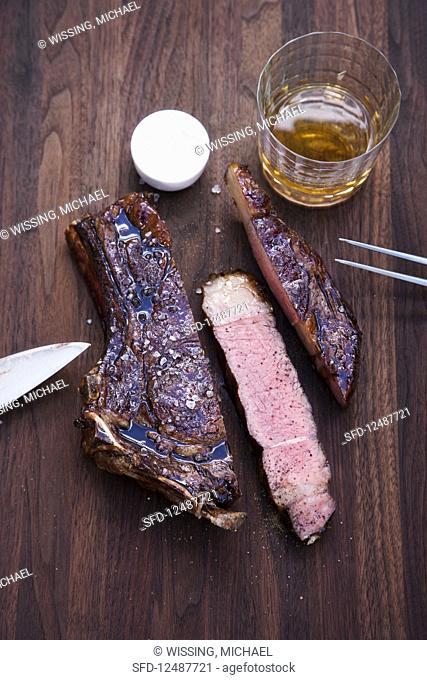 Grilled American rib-eye steak with a Bourbon glaze