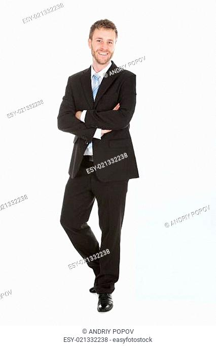 Businessman Leaning Over White Background
