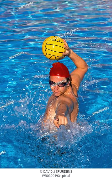 Water polo player lines up ball for goal