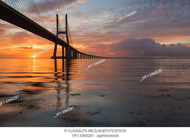 Sunrise colors in Tagus River and frame the Vasco da Gama bridge in Lisbon Portugal Europe