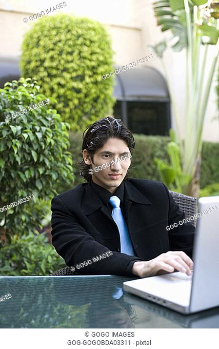 Businessman using laptop outdoors