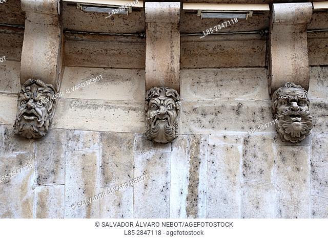 Pont Neuf detail of stone masks, Île de la Cité, Paris France