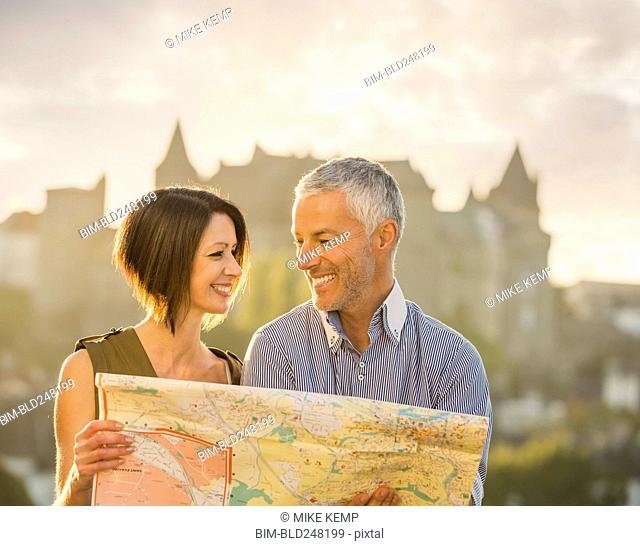 Caucasian couple reading map