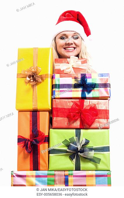 Cheerful Christmas woman with many presents, isolated on white background