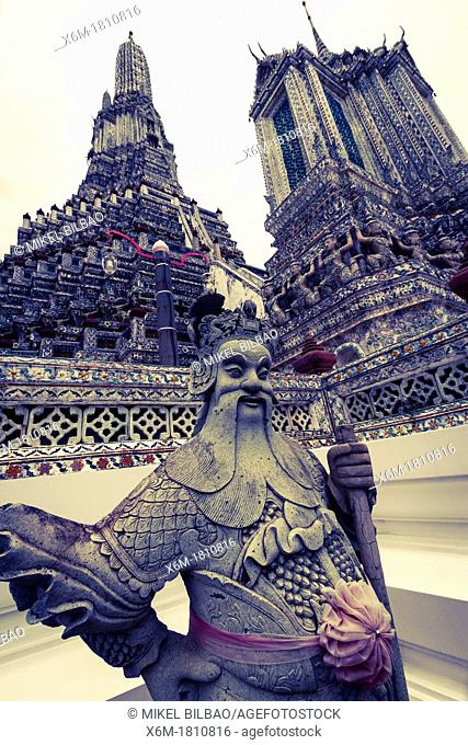 Stone giant  Wat Arun Rajwararam or Temple of the Dawn  Bangkok, Thailand