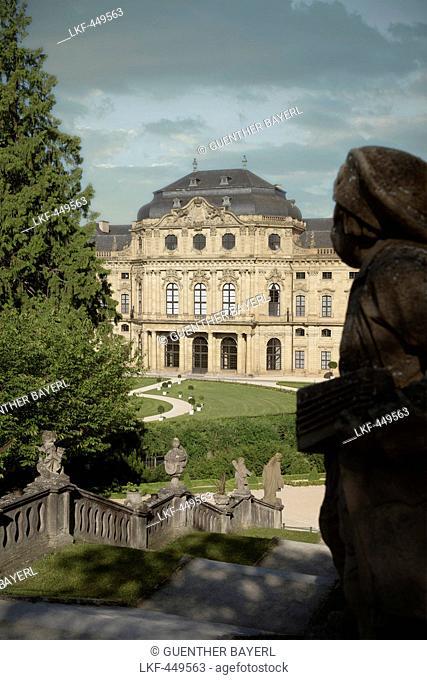 Stone sculpture looking at Residenz, baroque era, Wuerzburg, Franconia, Bavaria, Germany, UNESCO