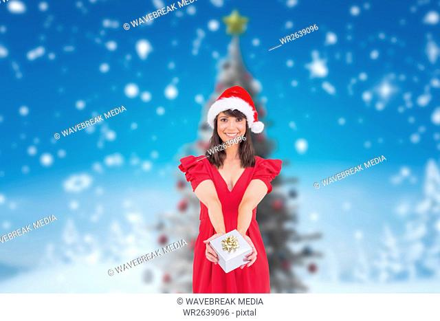 Beautiful woman in santa hat holding a gift box