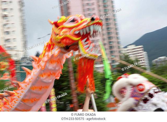 Lion dance & dragon dance celebrating Tam Kung festival at Tam Kung temple, Shaukeiwan, Hong Kong