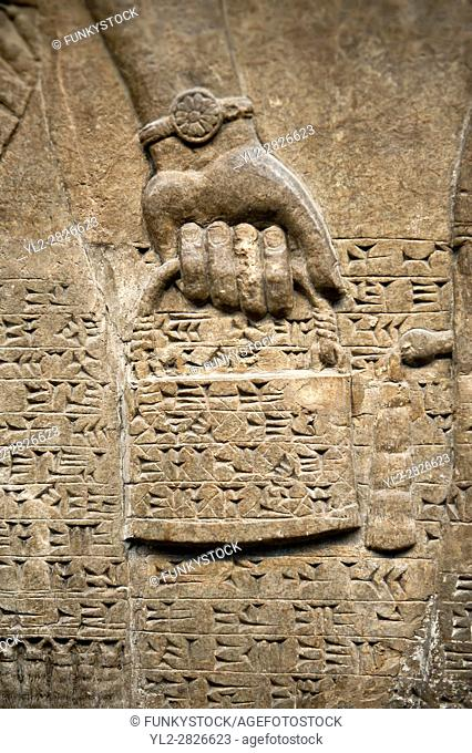Assyrian relief sculpture panel detail of a hand holding a bucket of holy water. From Nimrud, Iraq, 865-860 B. C North West Palace