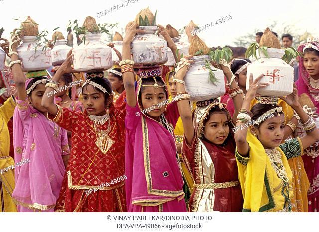Rajasthnai Girls carrying kalash on desert festival ; jaisalmer ; rajasthan ; india